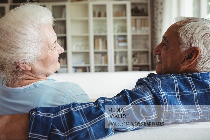 Senior couple sitting together at home