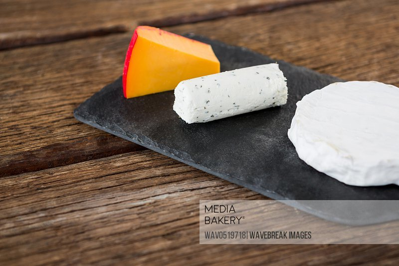 Variety of cheese on slate plate