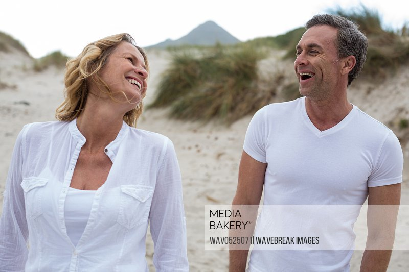 Mature couple enjoying together on the beach