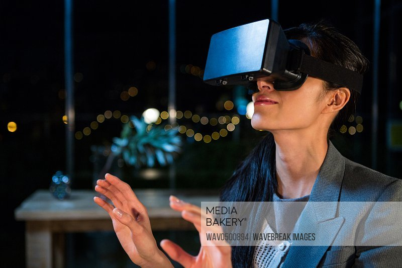 Businesswoman using virtual reality headset in the office