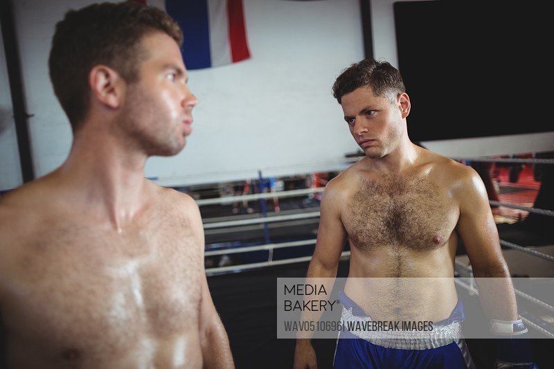 Boxer preparing for fight in boxing ring
