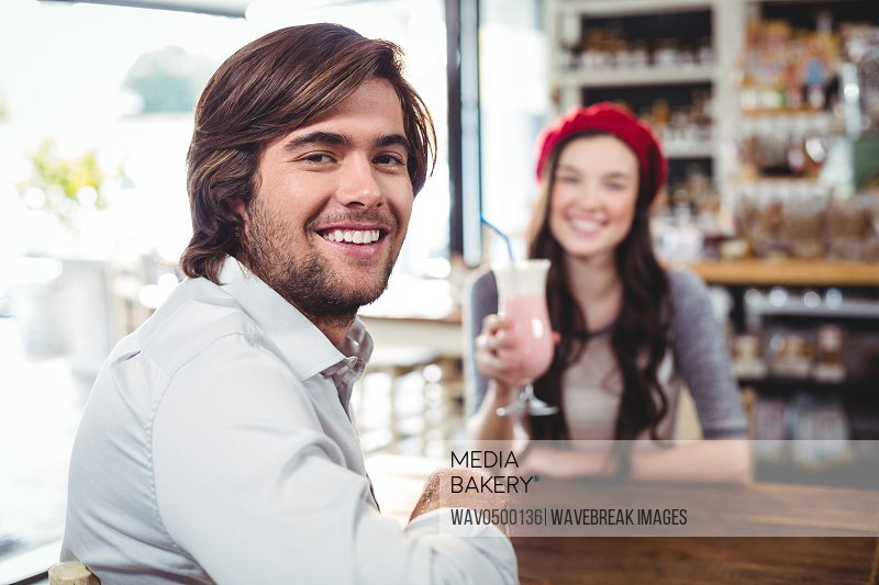 Portrait of smiling man sitting in cafe