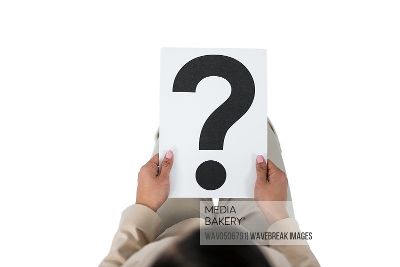 Businesswoman holding a question mark sign against white background