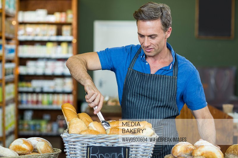 Male staff working at bakery store in supermarket