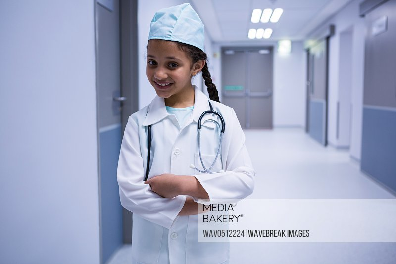 Portrait of smiling girl pretending to be a doctor in hospital