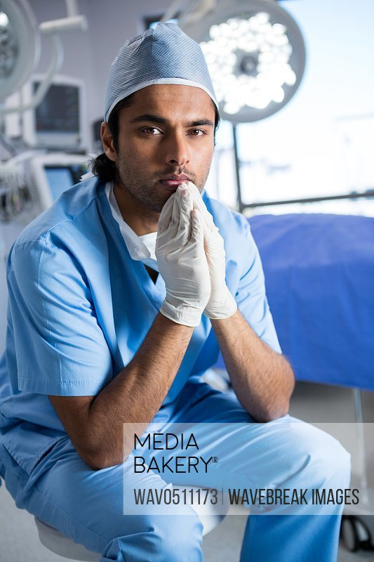 Portrait of male surgeon sitting in operation theater