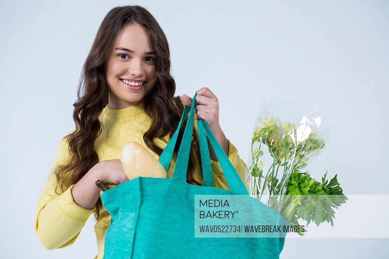 Beautiful woman carrying grocery bag