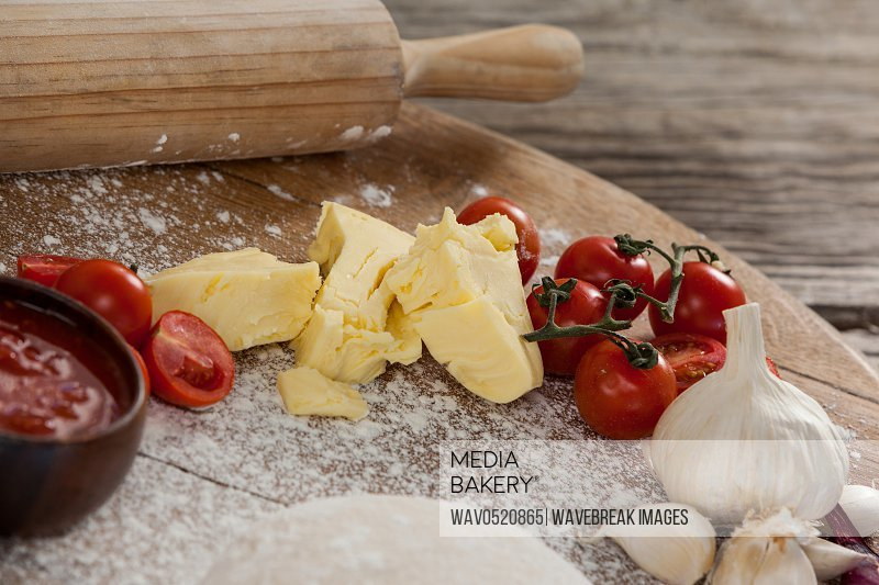 Pizza dough flour rolling pin with ingredient