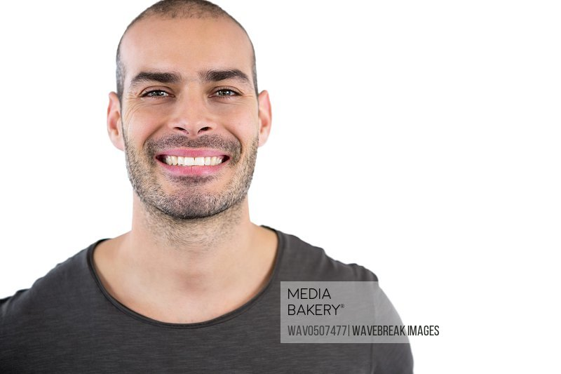 Portrait of man smiling against white background