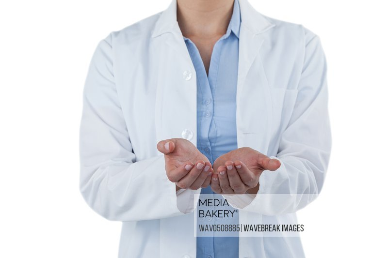 Mid-section of female doctor standing with hands cupped