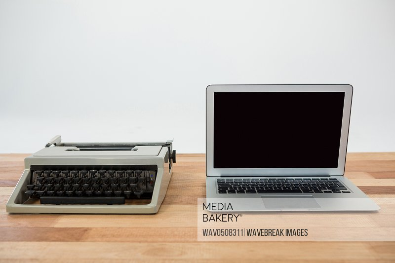 Old and modern technology concept on table