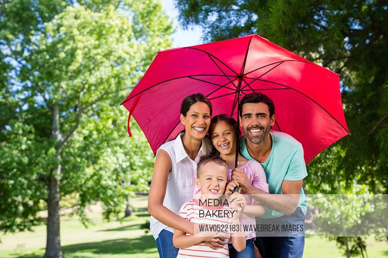 Portrait of happy family enjoying time together in the park