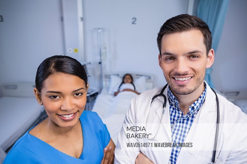 Portrait of smiling doctor and nurse standing together