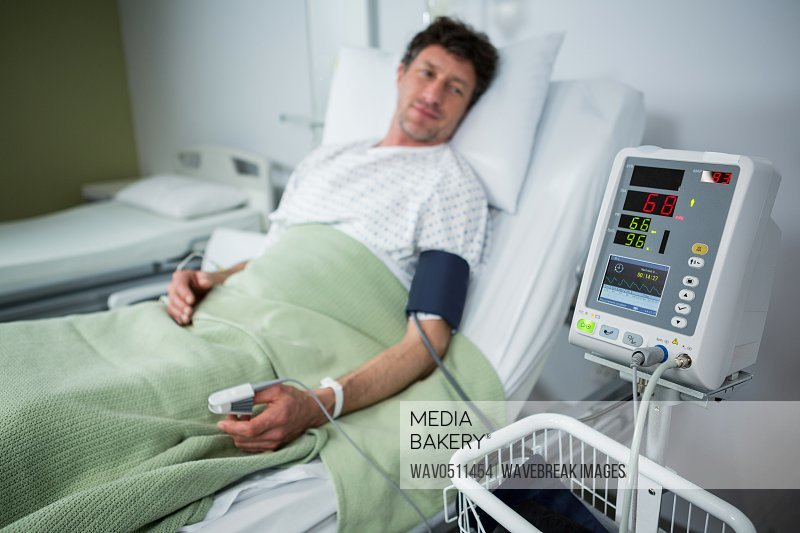 Patient looking his pulse rate in machine at hospital