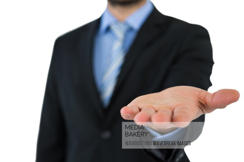 Mid section of businessman gesturing on white background