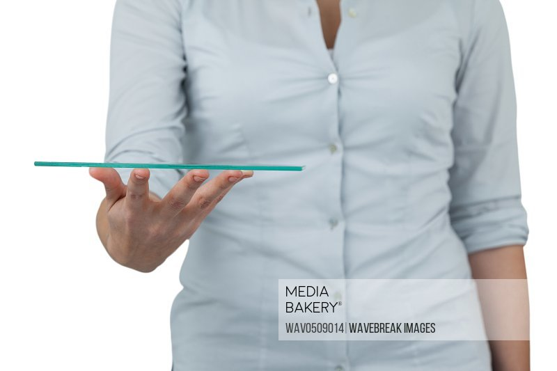 Mid section of businesswoman pretending to hold digital tablet