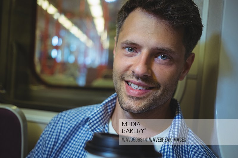Portrait of handsome man travelling in train