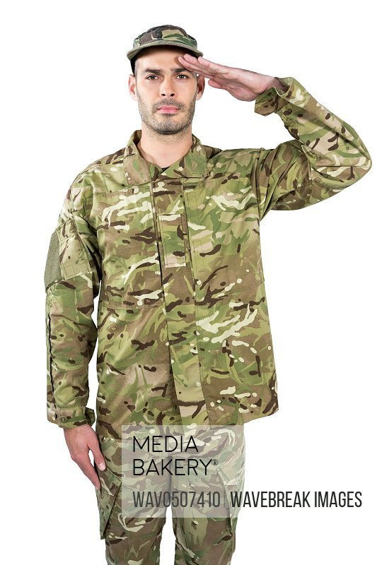Portrait of confident soldier saluting against white background