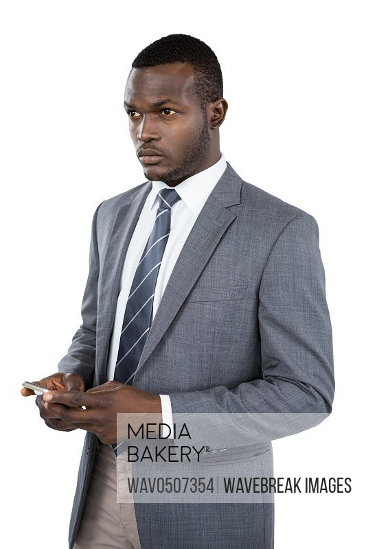 Businessman holding mobile phone against white background