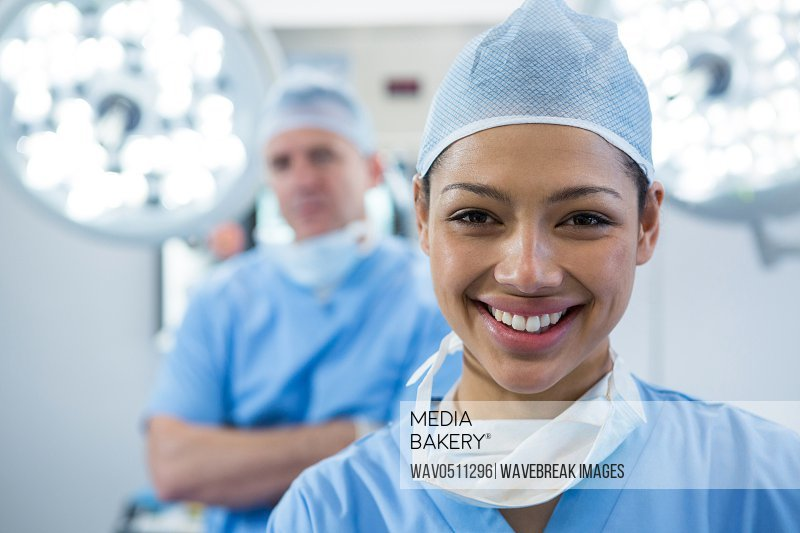 Portrait of female surgeon smiling in operation theater