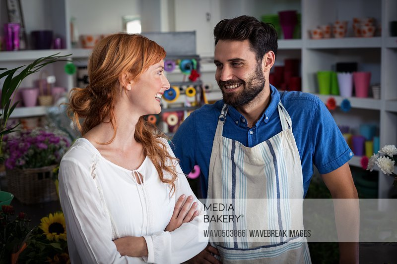 Couple looking at each other and smiling in the flower shop
