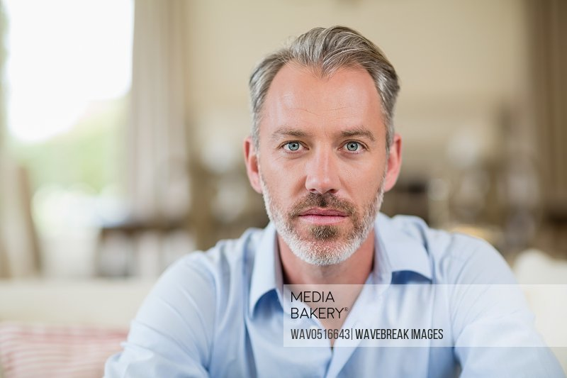 Confident man sitting in living room