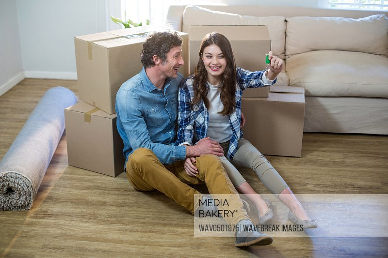 Happy couple holding the key of new home