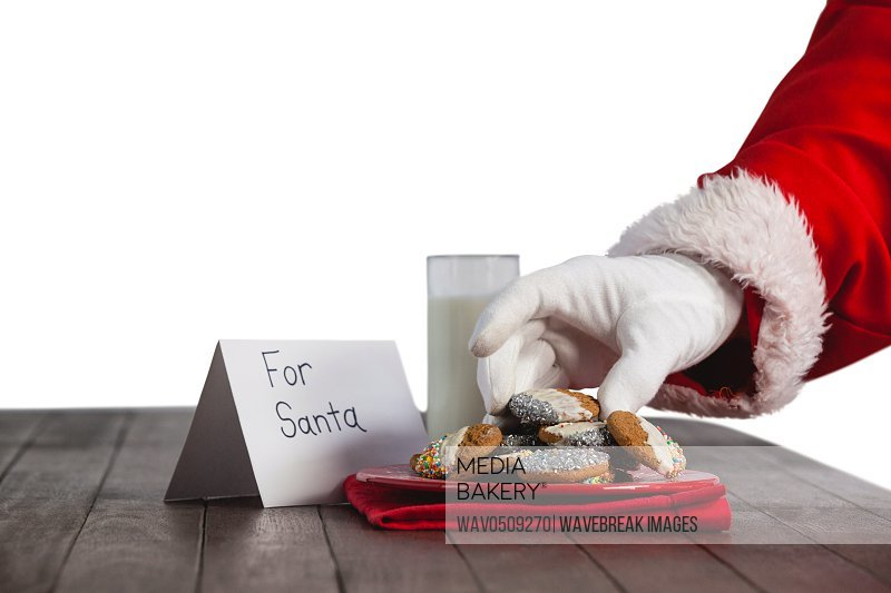 Close-up of santa claus taking cookies