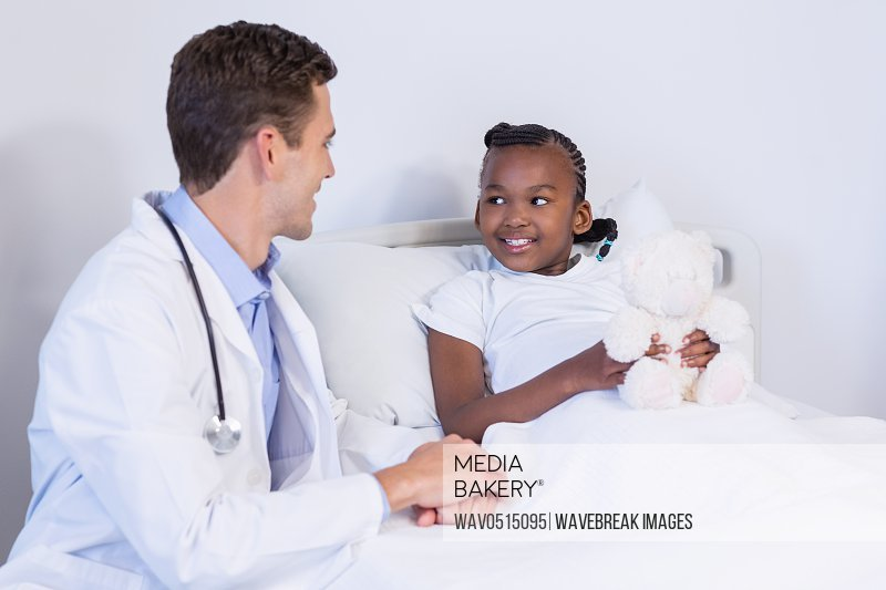 Doctor talking to a girl patient
