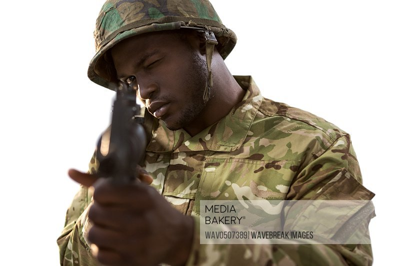 Soldier aiming with a rifle against white background