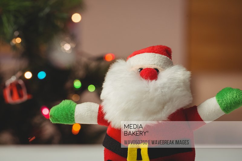 Close-up of santa claus on wooden table during christmas time