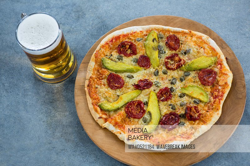 Italian pizza served with a mug of beer