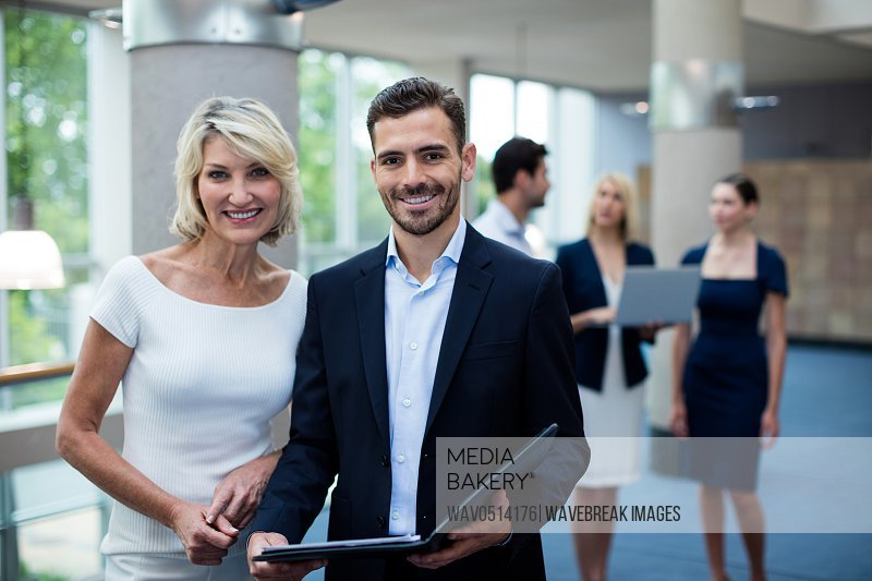 Portrait of business executives smiling at camera