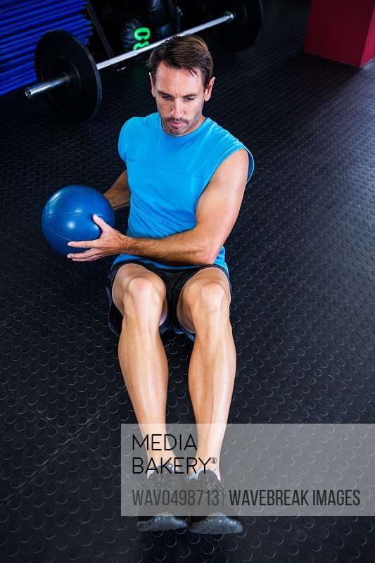 High angle view of male athlete holding ball in gym