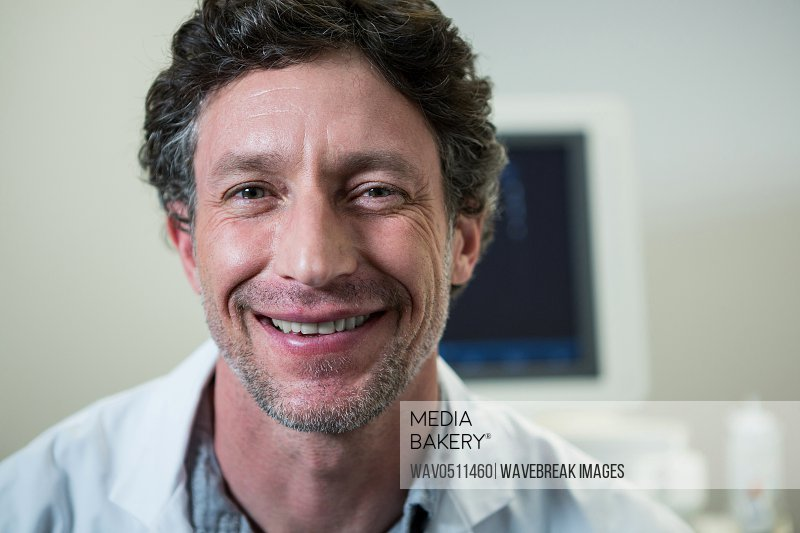 Portrait of doctor smiling at camera in hospital