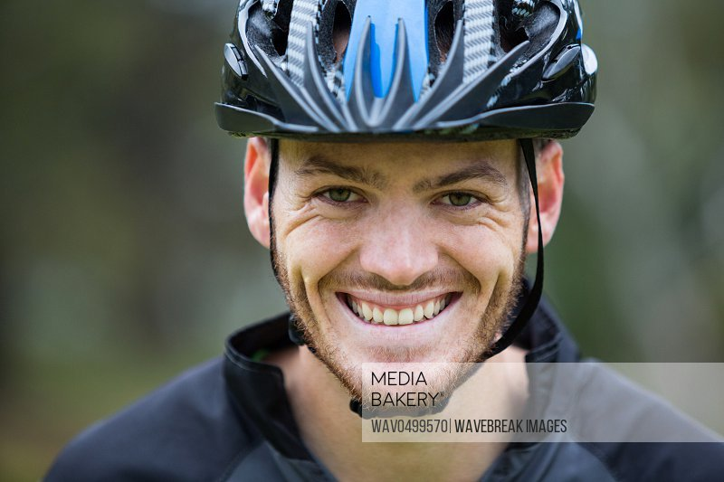 Portrait of smiling male athletic in park