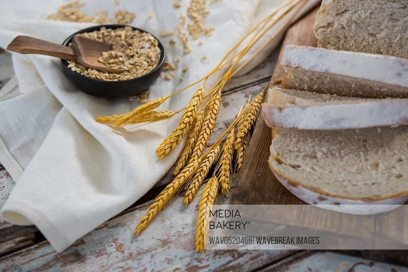 Slices of bread with wheat grains and oats