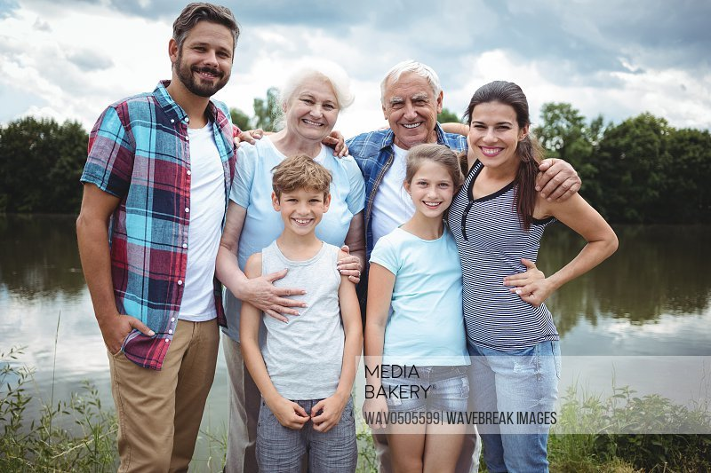 Portrait of happy multi-generation family standing near a river