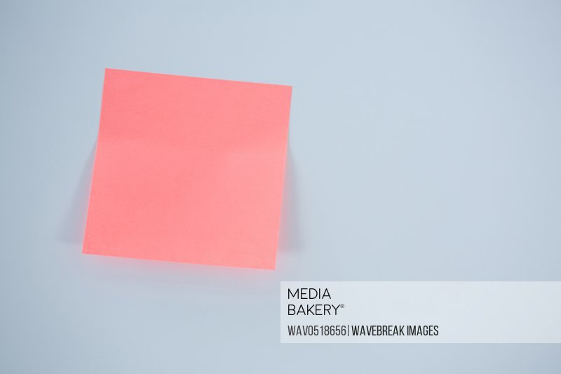 Close-up of pink adhesive note