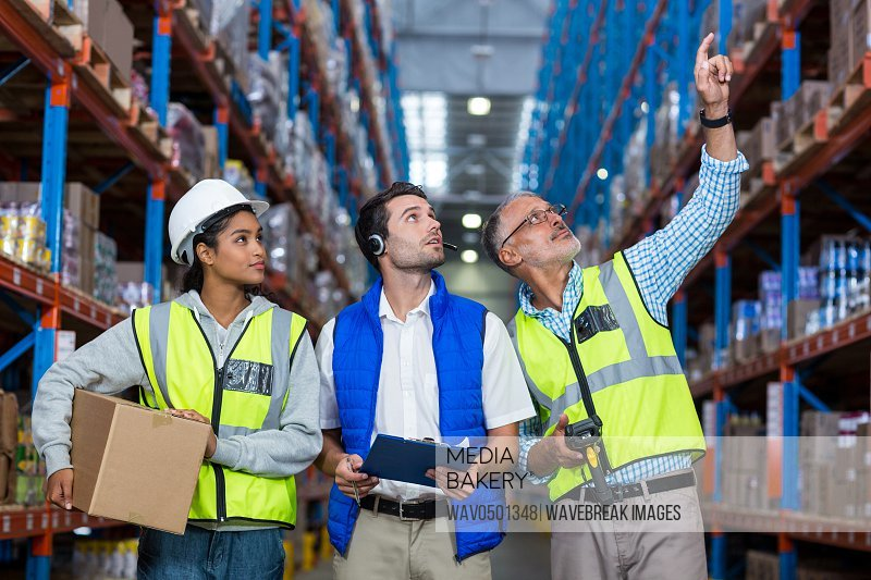 Warehouse workers interacting with each other in warehouse