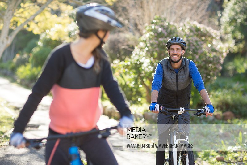 Biker couple cycling in countryside on a sunny day