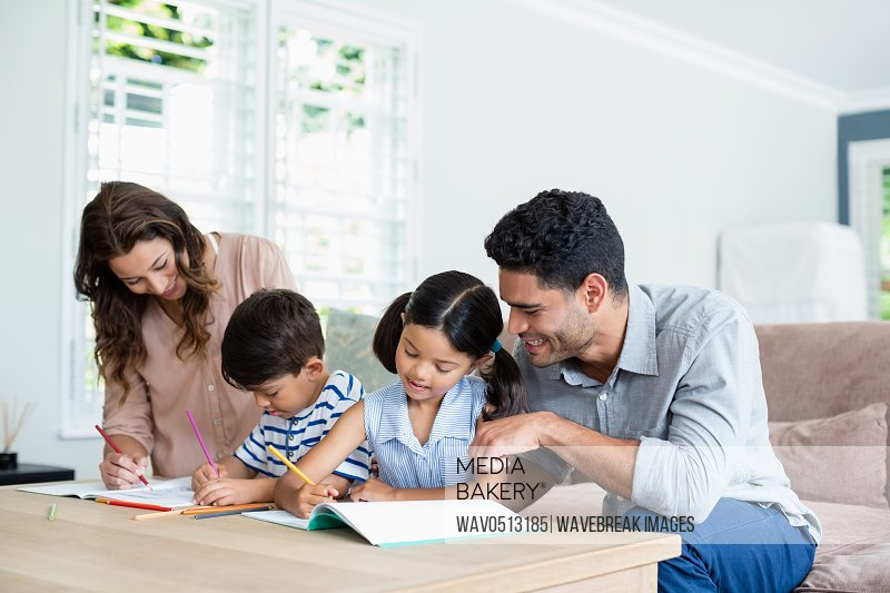 Parents assisting their kids in doing homework