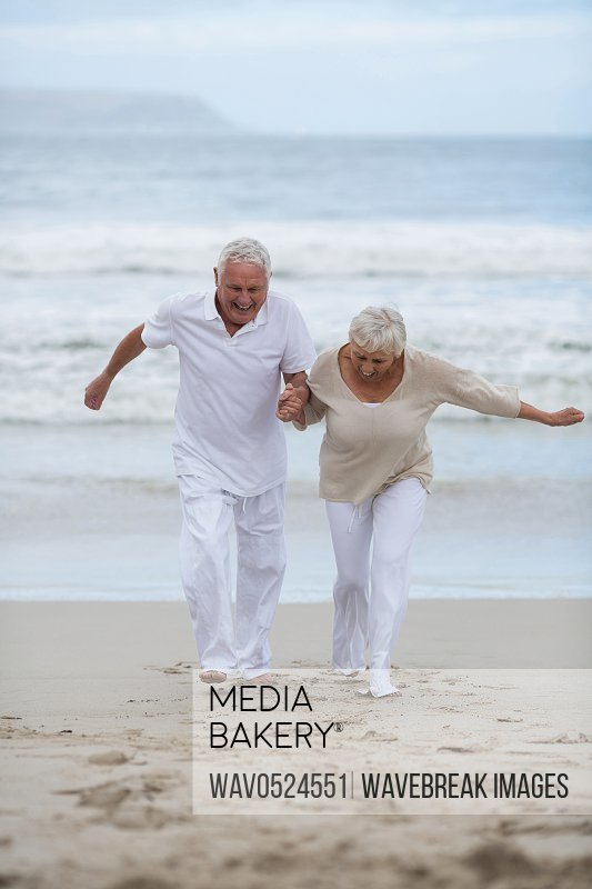 Senior couple having fun together at beach