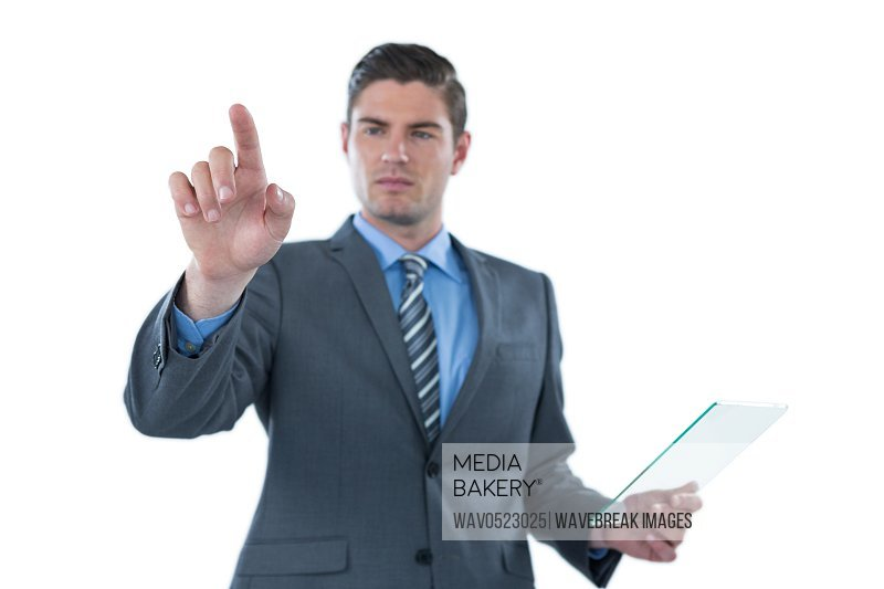 Businessman holding a futuristic digital tablet and touching an digital screen