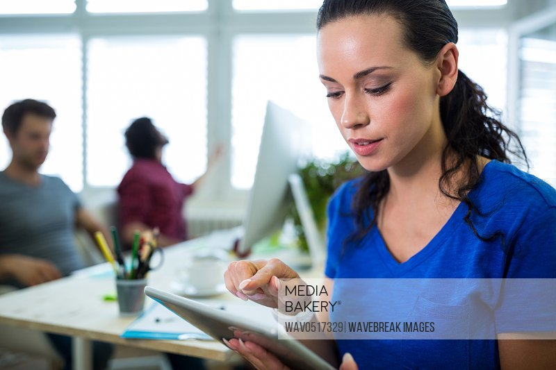 Female business executive using digital tablet