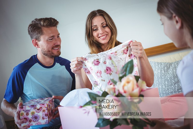 Daughter giving present to her mother at home