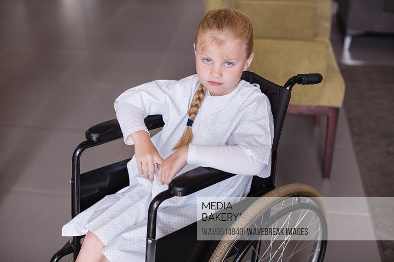 Portrait of sad girl patient sitting on a wheelchair