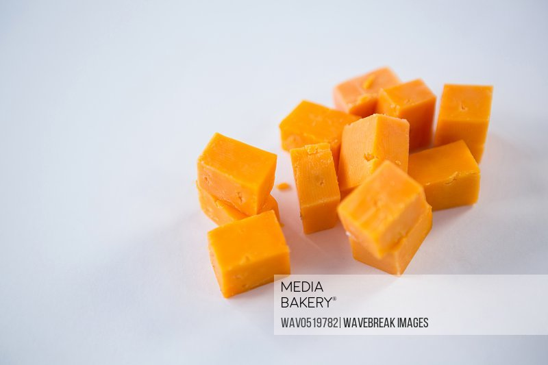 Cheese cubes on white background
