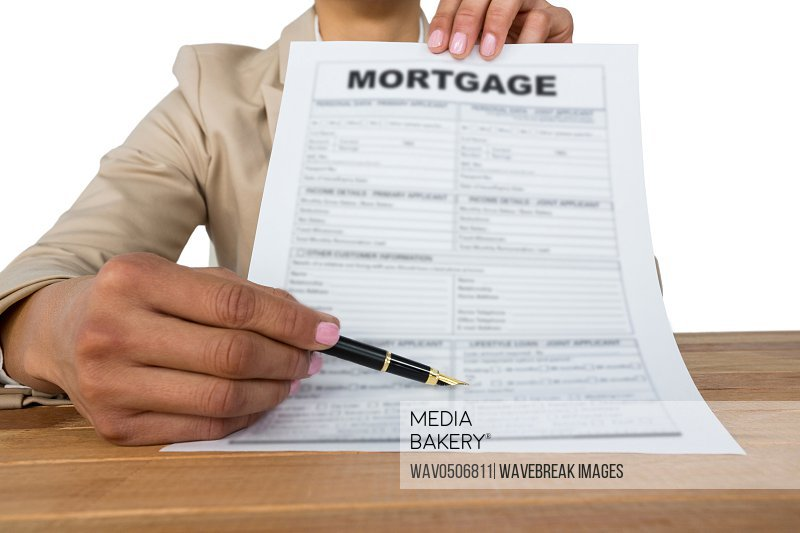 Mid section of businesswoman showing mortgage contract against white background
