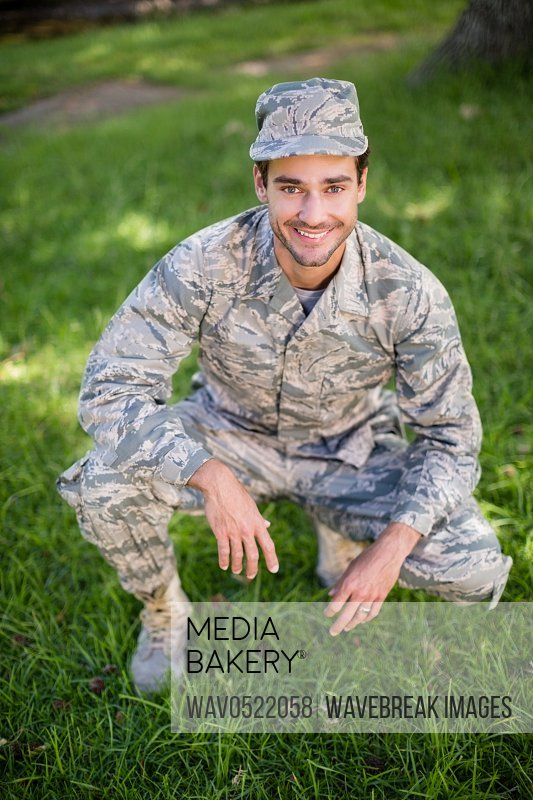 Portrait of soldier smiling in park